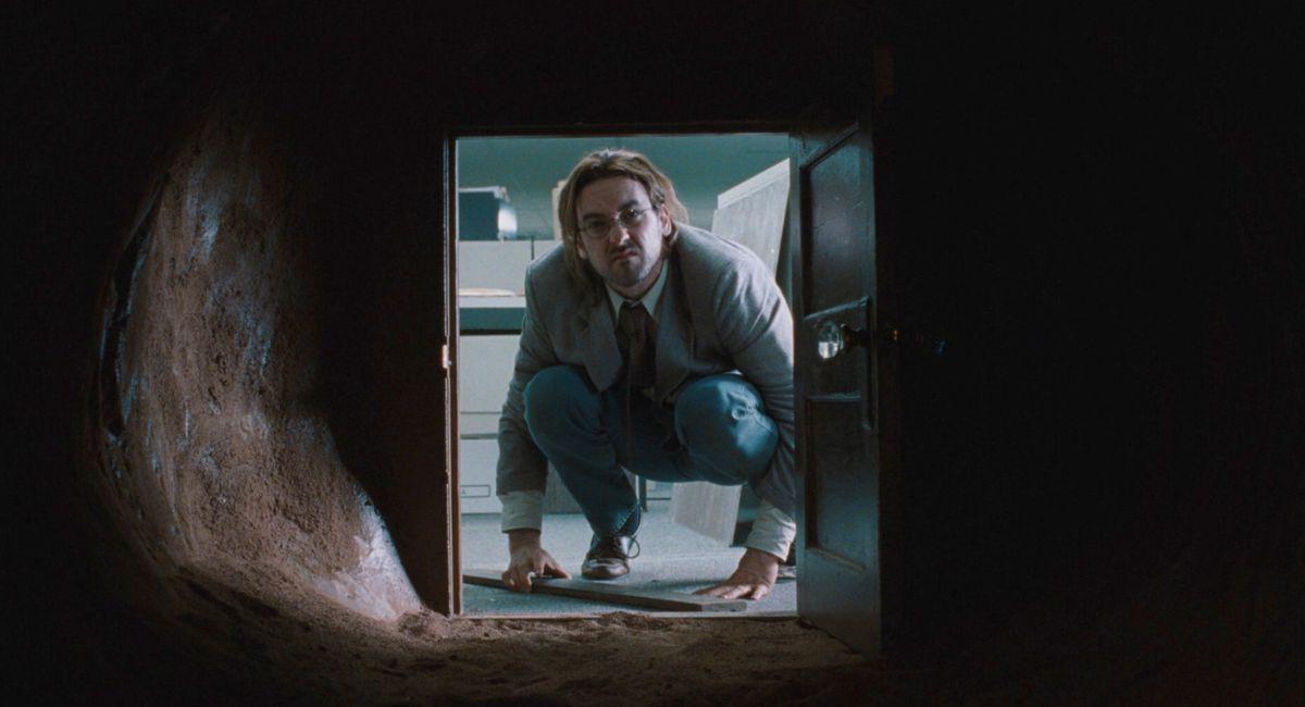 John cusack looks into the john malkovich portal in being john malkovich