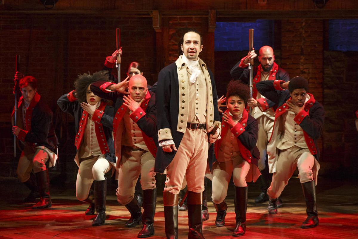 """This image released by The Public Theater shows Lin-Manuel Miranda, foreground, with the cast during a performance of """"Hamilton,"""" in New York."""