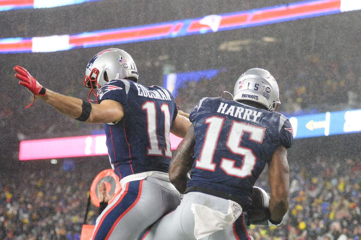 Julian Edelman celebrates with N'Keal Harry of the New England Patriots after scoring a touchdown against the Dallas Cowboys in the first quarter at Gillette Stadium on November 24, 2019 in Foxborough, Massachusetts.
