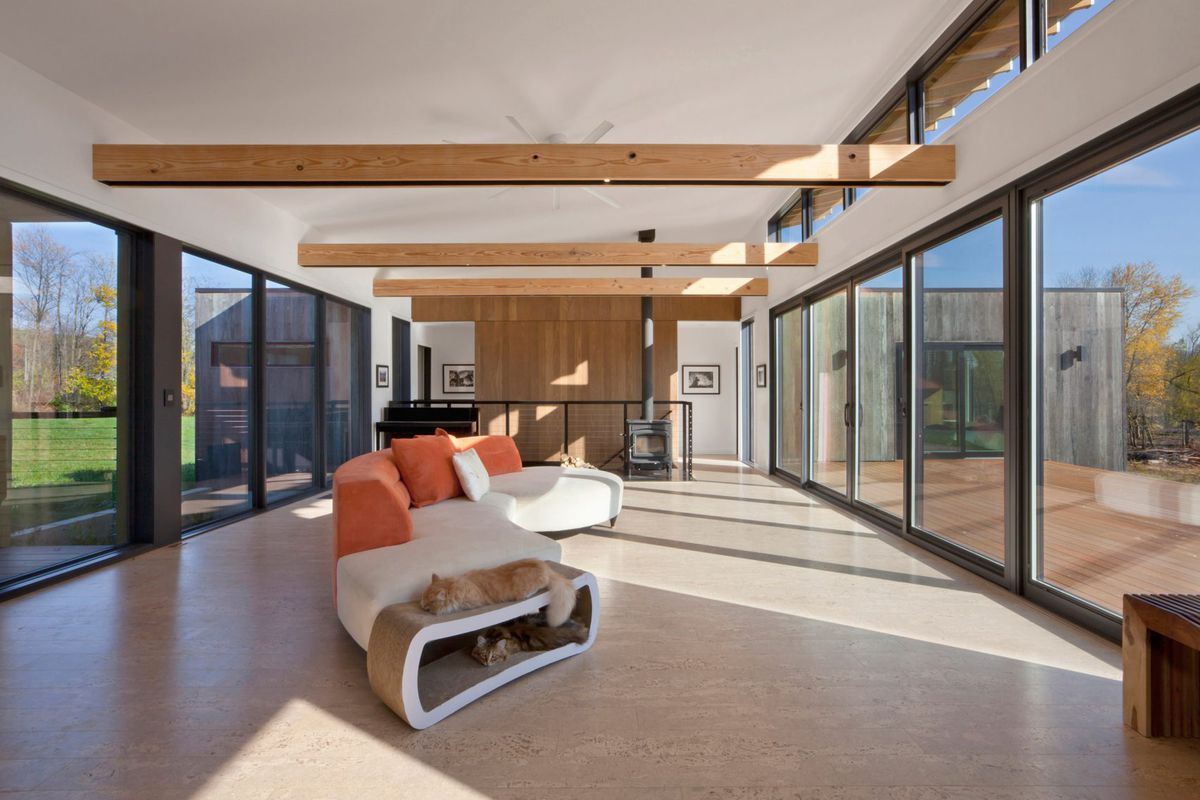 Haus Modern energy efficient modern home extends roof to shelter an airstream