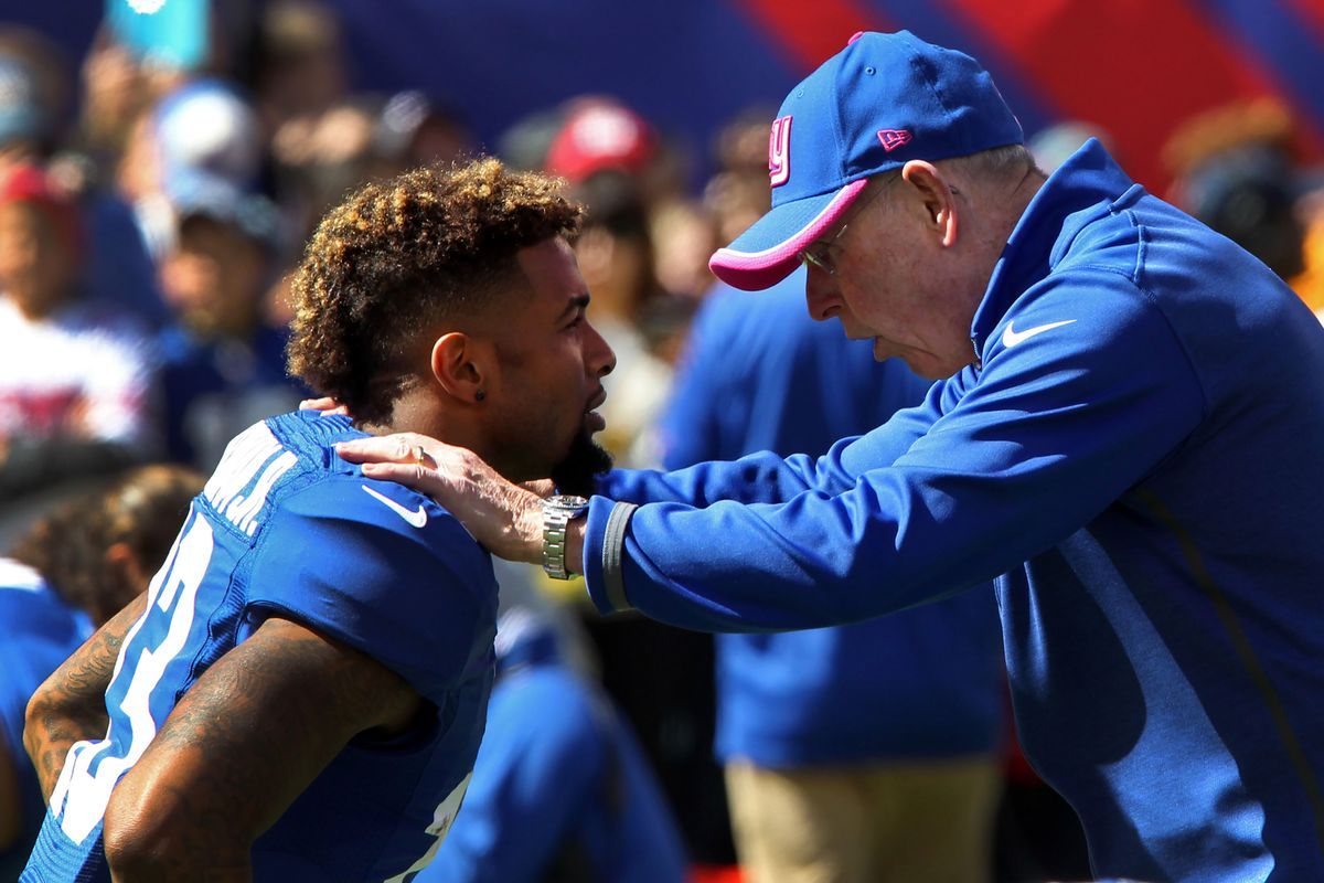 Tom Coughlin speaks with Odell Beckham before Sunday's game