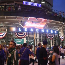 6:24 p.m. The crowd outside of the bleacher gate -
