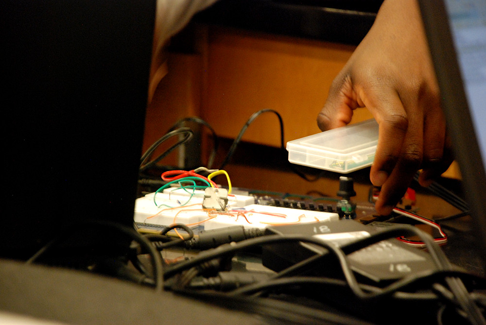 Students work on a computer switch board during an electronics class at Rangeview High School.