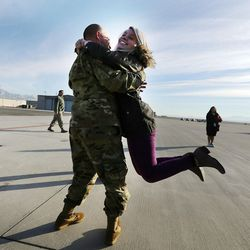 Chief Warrant Officer Gist Wylie swings his daughter, Rachel, as soldiers from Detachment 2, 101st Airborne Division (Air Assault) return to Utah on Friday, Nov. 18, 2016, following an 11-month deployment to Iraq.