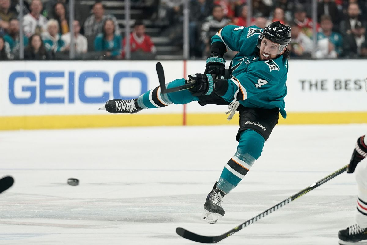San Jose Sharks defenseman Brenden Dillon (4) shoots the puck against the Chicago Blackhawks during the first period at SAP Center at San Jose.