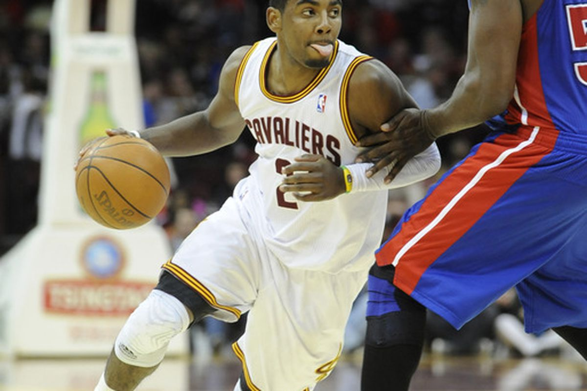 Mar 28, 2012; Cleveland, OH, USA; Cleveland Cavaliers point guard Kyrie Irving (2) drives around Detroit Pistons forwardcenter Jason Maxiell (54) in the third quarter at Quicken Loans Arena. Mandatory Credit: David Richard-US PRESSWIRE