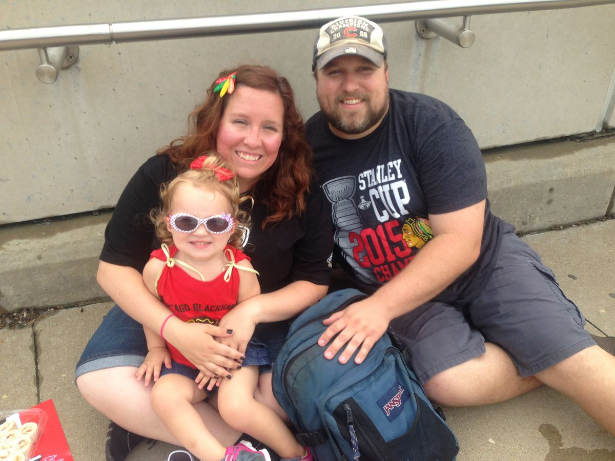 """Doug Rindfleisch and Elle Wilson made the trip with 2-year-old Scarlet from McHenry, catching the Metra at 6:30 a.m.<br>""""Our daughter has got to experience it,"""" Doug said. 