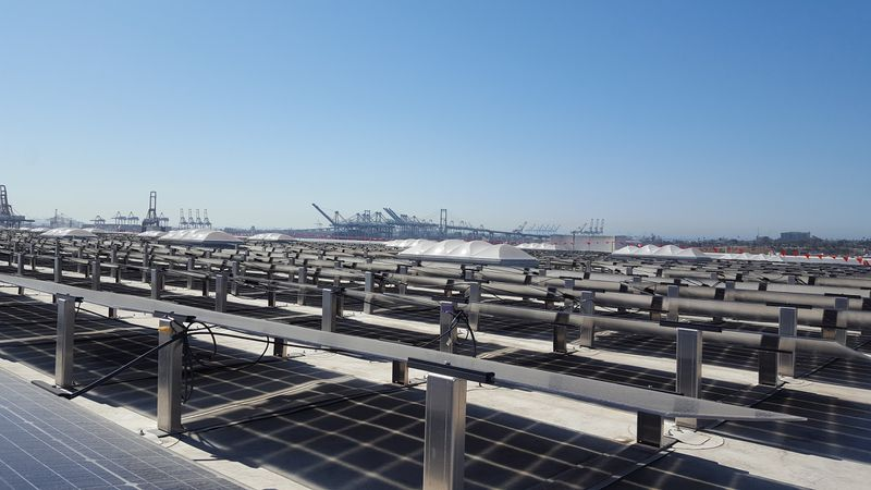 Solar panels with Vincent Thomas bridge in background
