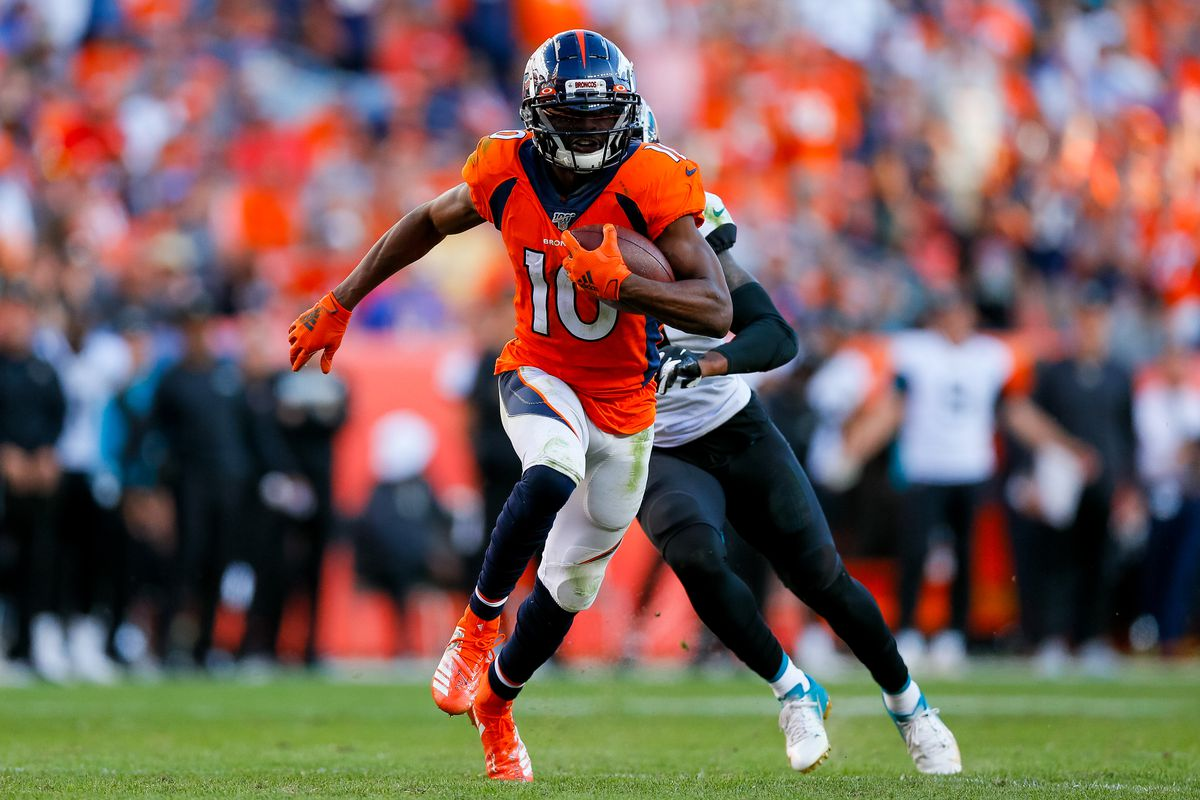 Wide receiver Emmanuel Sanders of the Denver Broncos runs with the football away from Cornerback A.J. Bouye of the Jacksonville Jaguars during the fourth quarter at Empower Field at Mile High on September 29, 2019 in Denver, Colorado.