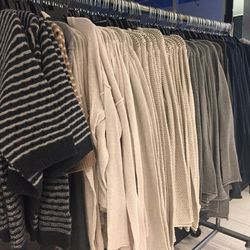 Women's collection sweaters, $150