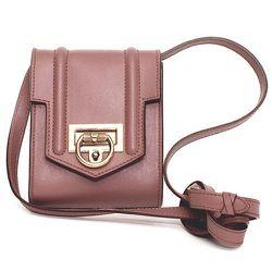 "<b>Reece Hudson</b> Siren Mini Bag in Rose Taupe, <a href=""http://shop.dagnyandbarstow.com/collections/handbags/products/reece-hudson-siren-mini-bag"">$495</a> at Dagny+Barstow"