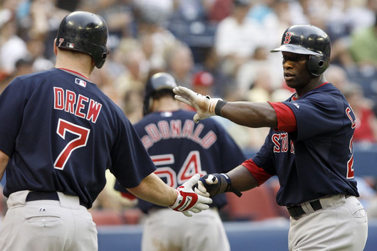 TORONTO - JULY 9: Mike Cameron #23 and J.D. Drew #7 of the Boston Red Sox celebrate runs during a MLB game against the Toronto Blue Jays at The Rogers Centre on July 9 2010 in Toronto Ontario Canada. (Photo by Abelimages/Getty Images)