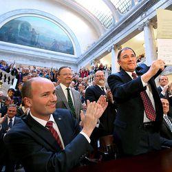 Gov. Gary Herbert holds up a copy of SB296 after signing it at the Capitol in Salt Lake City, Utah, on Thursday, March 12, 2015.  Applauding is Lt. Gov. Spencer Cox, Sen. Stuart Adams, R-Layton, Sen. Stephen Urquhart, R-St. George, Rep. Brad Dee, R-Ogden, House Speaker Greg Hughes, R-Draper, and Senate President Wayne Neiderhauser, R-Sandy.