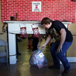 Austin Hawks pulls bags of goods for families during 2014 Operation Chimney Drop at Head Start in Salt Lake City, Monday, Dec. 15, 2014.