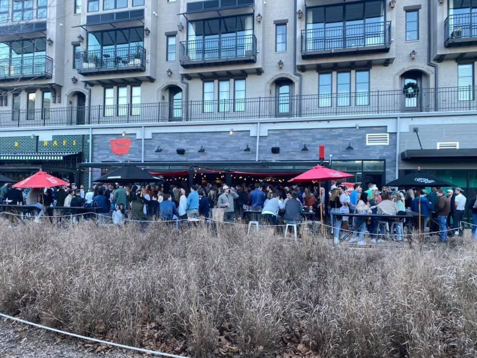 Saturday, January 23, 2021 a large crowd on the patio at Pour Taproom on the betline during the covid-19 pandemic in Atlanta