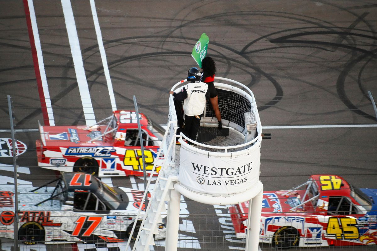 The honorary starter waves the green flag for the World of Westgate 200 NASCAR Gander RV & Outdoors Truck Series Playoff Race on Sept. 25, 2020 at Las Vegas Motor Speedway in Las Vegas, Nevada.