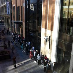 Shoppers line up outside the new Macy's store at City Creek during the mall's grand opening Thursday,  March 22, 2012.
