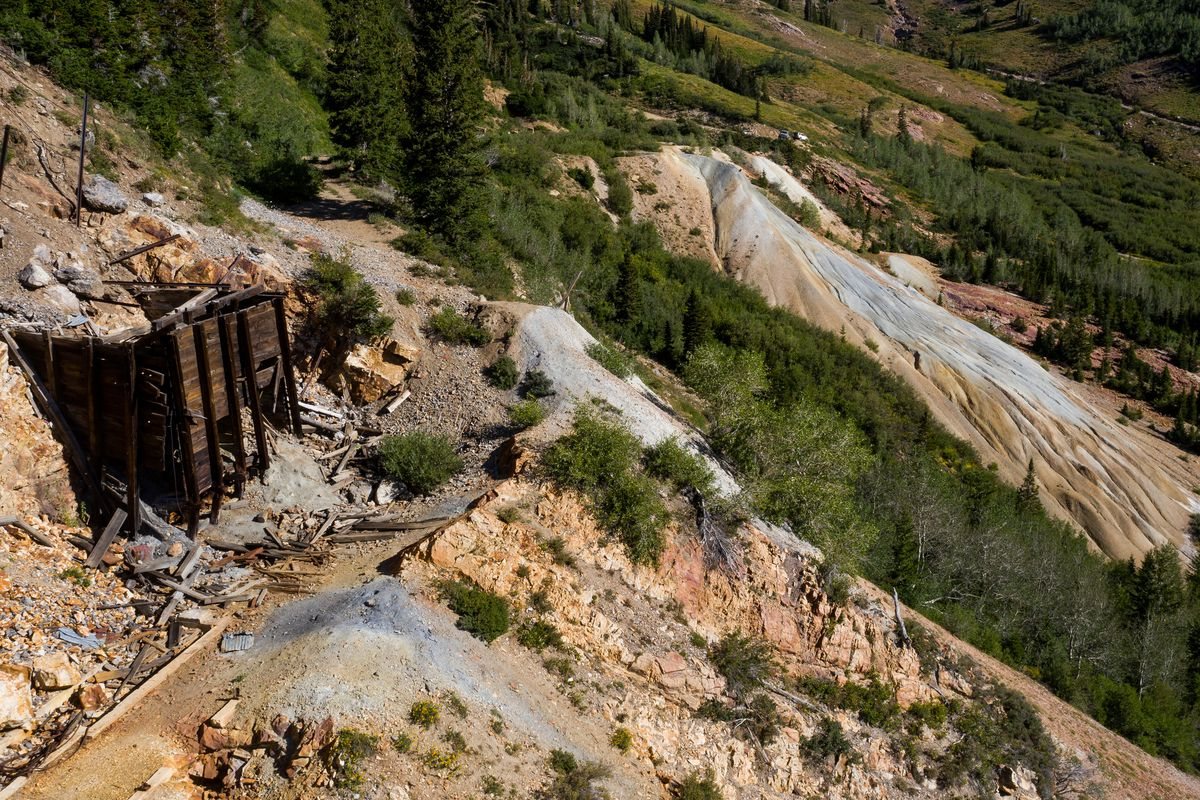 An old structure and piles of tailings, the waste product left over from mining operations, are seen at the former Yankee Mine in Mary Ellen Gulch, a basin near the top of American Fork Canyon, on Saturday, Aug. 15, 2020.