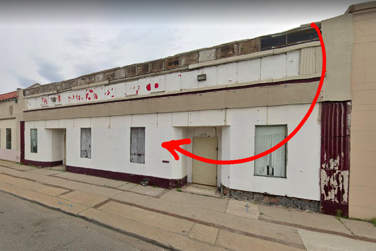 A red arrow pointing to the left at a white and red storefront on McNichols.