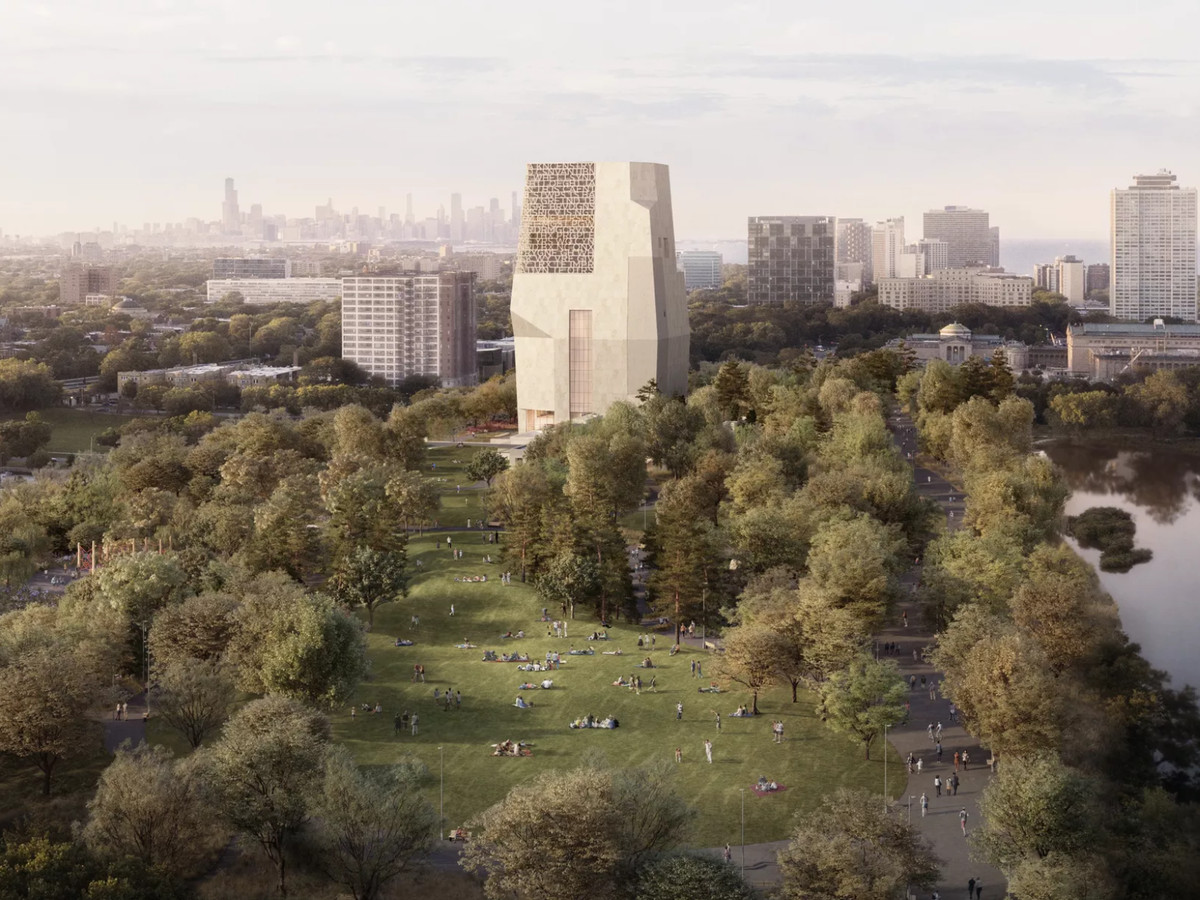 An aerial rendering of an angular stone-clad tower above a sprawling park filled with trees, a lagoon, and play fields. A line of taller buildings and a large body of water is visible in the distance.