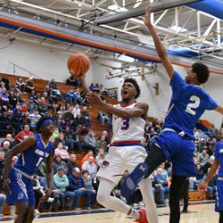 DaJuan Gordon (3) of Curie makes a layup over Bloom's Matrice Mitchell (2), Saturday 12-29-18. Worsom Robinson/For Sun-Times