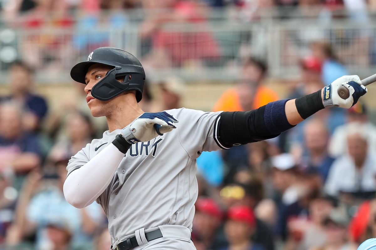 Aaron Judge #99 of the New York Yankees hits a solo home run against the Minnesota Twins in the first inning of the game at Target Field on June 9, 2021 in Minneapolis, Minnesota.