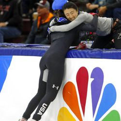 Lana Gehring (2) celebrates with coach Linlin Sun after winning the women's 1000-meter A final race during the U.S. Olympic short track speedskating trials Sunday, Dec. 17, 2017, in Kearns, Utah. (AP Photo/Rick Bowmer)