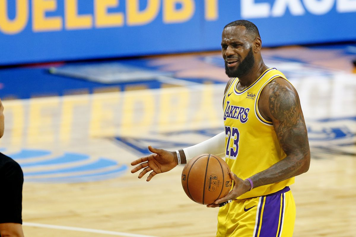 LeBron James of the Los Angeles Lakers questions a call during first half action at AT&T Center on January 1, 2021 in San Antonio, Texas.
