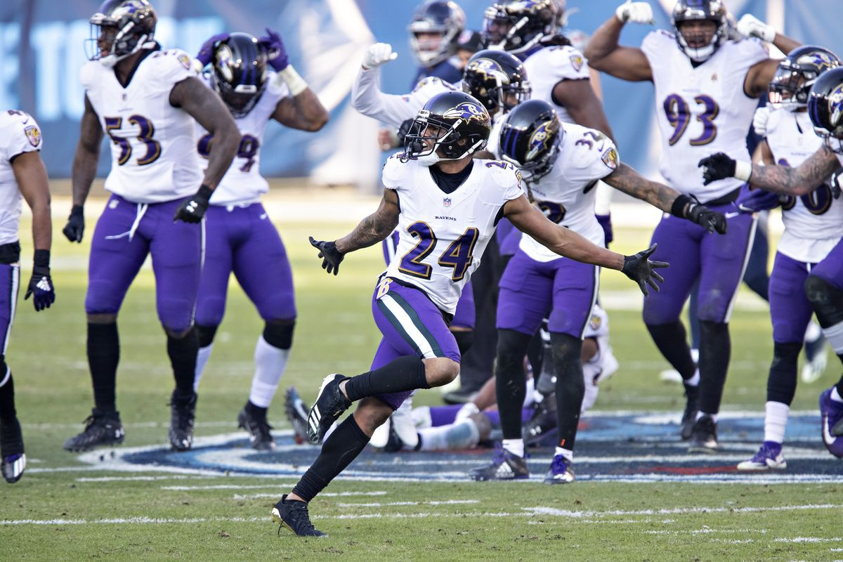 Cornerback Marcus Peters #24 of the Baltimore Ravens celebrates with teammates after his interception during their AFC Wild Card Playoff game against the Tennessee Titans at Nissan Stadium on January 10, 2021 in Nashville, Tennessee. The Ravens defeated the Titans 20-13.