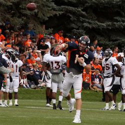 Denver Broncos quarterback Peyton Manning throws at the fourth day of Broncos training camp