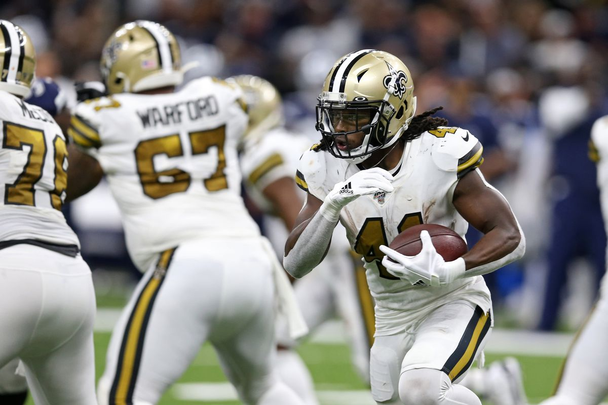 New Orleans Saints running back Alvin Kamara runs against the Dallas Cowboys in the second half at the Mercedes-Benz Superdome.