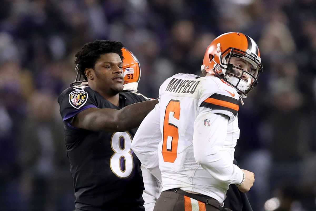 Quarterback Lamar Jackson of the Baltimore Ravens consoles quarterback Baker Mayfield of the Cleveland Browns late in the fourth quarter after Mayfield threw an interception during the Ravens 26-24 win at M&T Bank Stadium on December 30, 2018 in Baltimore, Maryland.