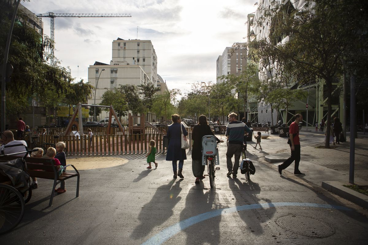 Silvia, Nora, and Patrick, neighbors and friends, chat in the Poblenou superblock. Taken October 15th, 2018. Barcelona, Catalonia, Spain.