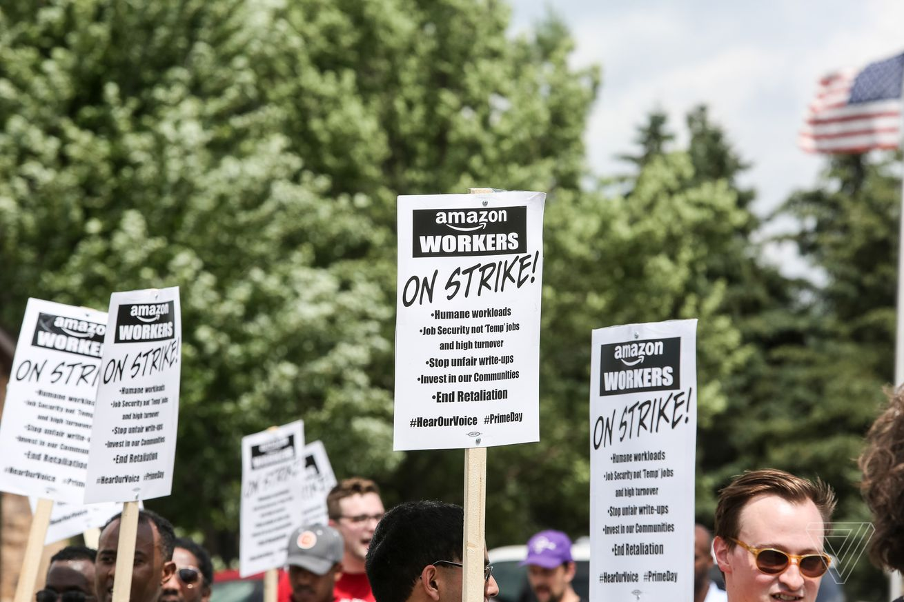 Amazon workers and their supporters protest outside of the Amazon Fulfillment Center on Prime Day in Shakopee, Minn