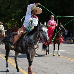 A parade participant from the Consulate of Mexico in Salt Lake City does rope tricks while riding a horse during the Days of '47 Parade on Friday, July 23, 2021.