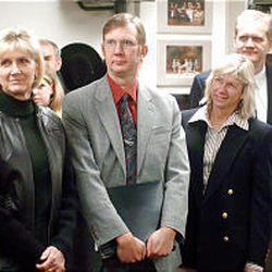 "Elizabeth Warner, left, Richard Engar, Kristin Cannon and William Engar, children of late PTC executive producer Keith M. Engar, at dedication of Simmons Pioneer Memorial Theatre's new ""Engar Room"" last week."