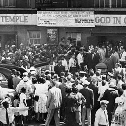 Pallbearers carry the casket of Emmett Till through a large crowd gathered outside Roberts Temple Church of God in Christ on Sept. 6, 1955, in Chicago.