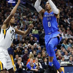 Oklahoma City Thunder guard Russell Westbrook goes up for a shot with Utah Jazz guard Rodney Hood defending during NBA basketball in Salt Lake City on Saturday, Dec. 23, 2017.