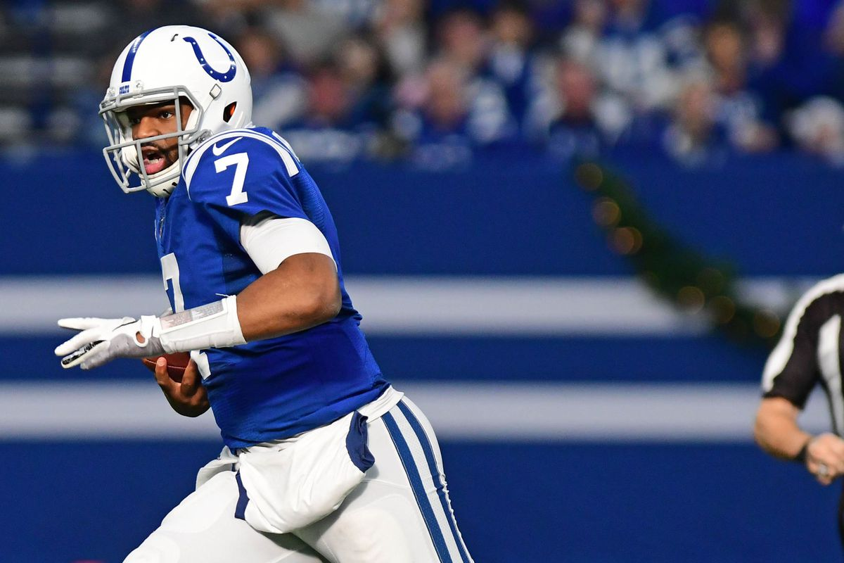 Indianapolis Colts quarterback Jacoby Brissett runs out of the pocket against the Carolina Panthers in the first half at Lucas Oil Stadium.