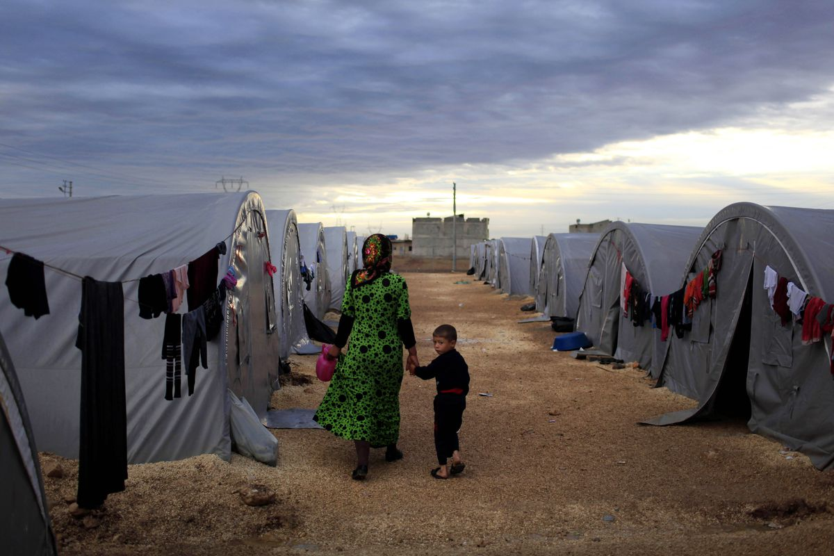 Refugees coming from the Syrian city of Kobane, now being contested by ISIS and Kurdish forces.
