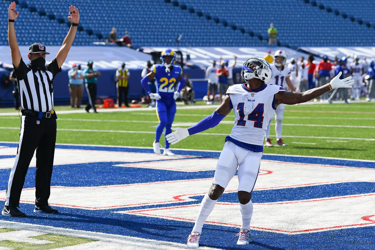 Buffalo Bills wide receiver Stefon Diggs (14) reacts after punting the ball into the stands following his touchdown catch against the Los Angeles Rams during the third quarter at Bills Stadium.