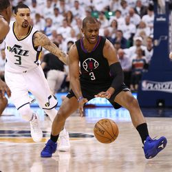 Utah Jazz guard George Hill (3) works to stay with LA Clippers guard Chris Paul (3) as the Utah Jazz and the LA Clippers compete in game 6 of the NBA playoffs at Vivint Smart Home Arena in Salt Lake City on Friday, April 28, 2017.