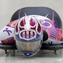 Noelle Pikus-Pace of the United States starts her third run during the women's skeleton competition at the 2014 Winter Olympics, Friday, Feb. 14, 2014, in Krasnaya Polyana, Russia.