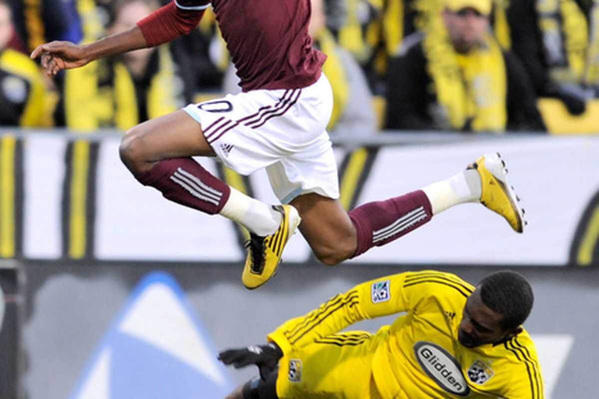 COLUMBUS OH - NOVEMBER 6:  Macoumba Kandji #10 of the Colorado Rapids leaps over Shaun Francis #29 of the Columbus Crew while chasing after a loose ball on November 6 2010 at Crew Stadium in Columbus Ohio.  (Photo by Jamie Sabau/Getty Images)