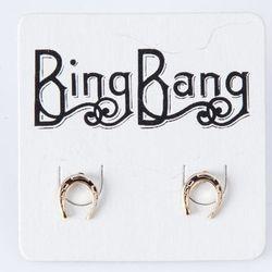 "<strong>Bing Bang</strong> Horseshoe Studs, <a href=""http://www.shopno3.com/products/bing-bang-horseshoe-studs"">$42</a> at No.3"
