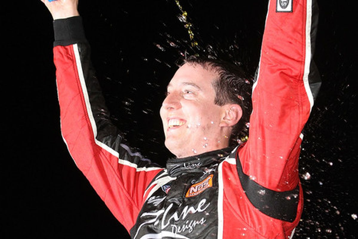 INDIANAPOLIS - JULY 24:  Kyle Busch driver of the #18 Fleet Locate Toyota celebrates after winning the NASCAR Nationwide Series Kroger 200 at O'Reilly Raceway Park on July 24 2010 in Indianapolis Indiana.  (Photo by Christian Petersen/Getty Images)