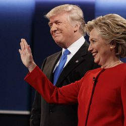 Republican presidential candidate Donald Trump, left, stands with Democratic presidential candidate Hillary Clinton before the first presidential debate at Hofstra University, Monday, Sept. 26, 2016, in Hempstead, N.Y.