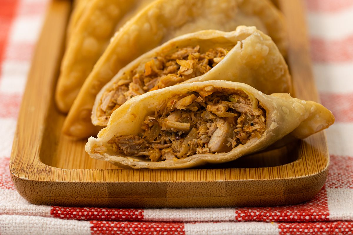 Chicken, beef, or spinach and mushroom empanadas from M'Panadas are now available through Foodhini's delivery service