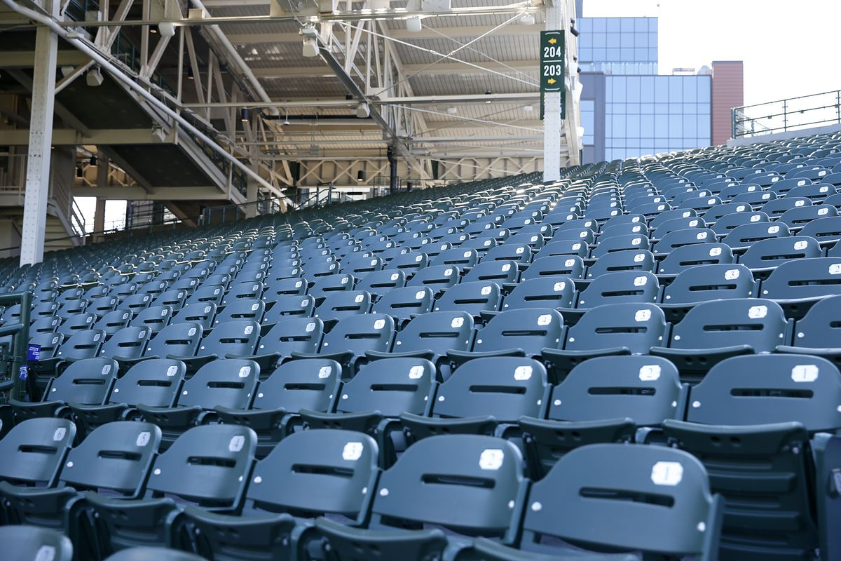 Empty seats are seen at Wrigley Field before the game between the Milwaukee Brewers and the Chicago Cubs at Wrigley Field on July 24, 2020 in Chicago, Illinois. The 2020 season had been postponed since March due to the COVID-19 pandemic.