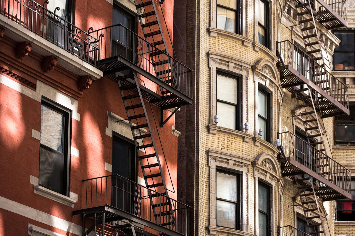 A close-up photograph of brick apartment building facades
